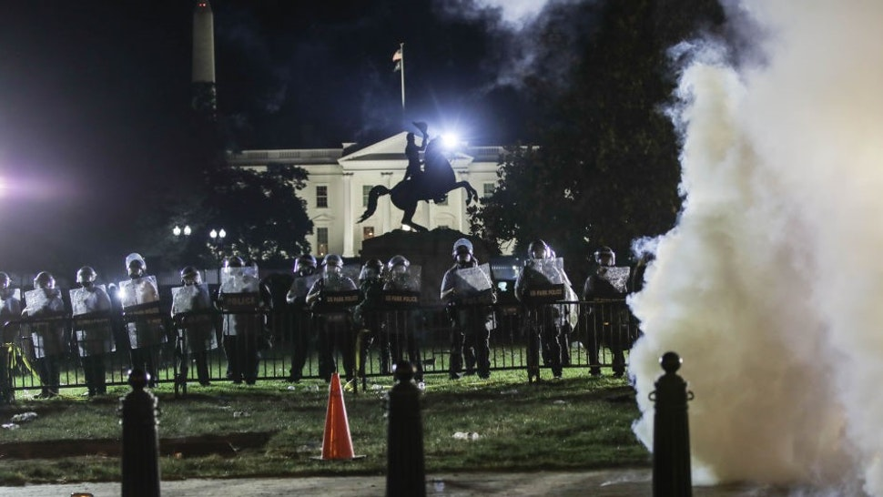 WASHINGTON, USA - JUNE 1: Police intervene in protesters with tear gas near White House during a protest over the death of George Floyd, an unarmed black man who died after being pinned down by a white police officer in Washington, United States on June 1, 2020. (Photo by