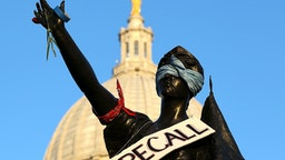 MADISON, WI - MARCH 10: A sign to recall Wisconsin Governor Scott Walker hangs on a statue in front of the Wisconsin State Capitol on March 10, 2011 in Madison, Wisconsin. Thousands of demonstrators continue to protest at the Wisconsin State Capitol as the Wisconsin House voted to pass the state's controversial budget bill one day after Wisconsin Republican Senators voted to curb collective bargaining rights for public union workers in a surprise vote with no Democrats present.
