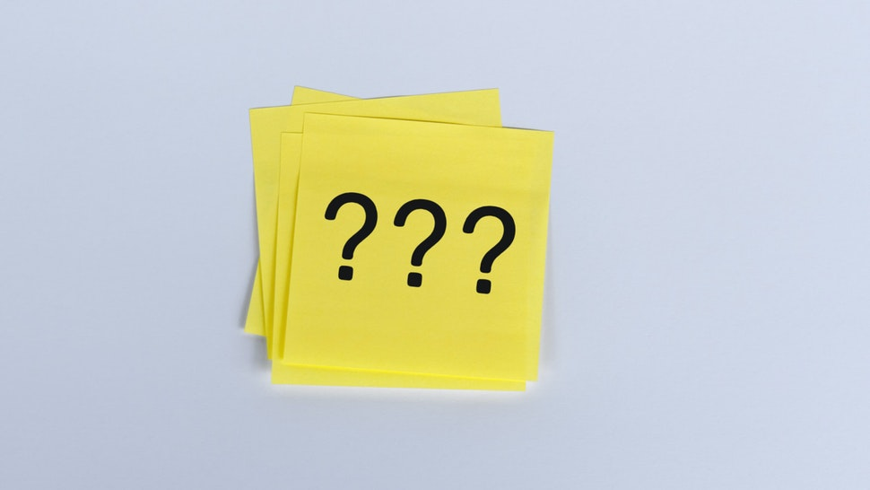 Sticky note question mark.