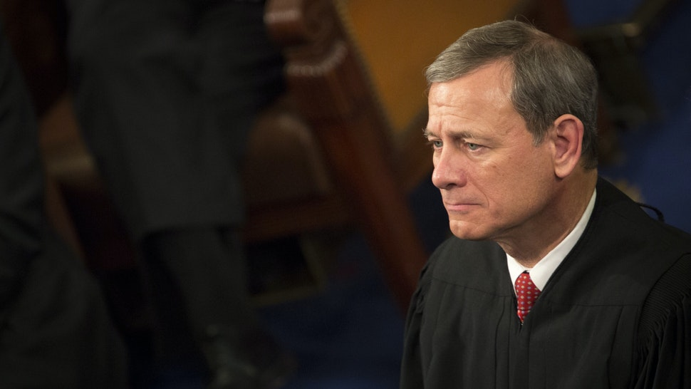 Chief Supreme Court Justice John Roberts listens as U.S. President Barack Obama delivers the State of the Union address to a joint session of Congress at the Capitol in Washington, D.C., U.S., on Tuesday, Jan. 12, 2016.