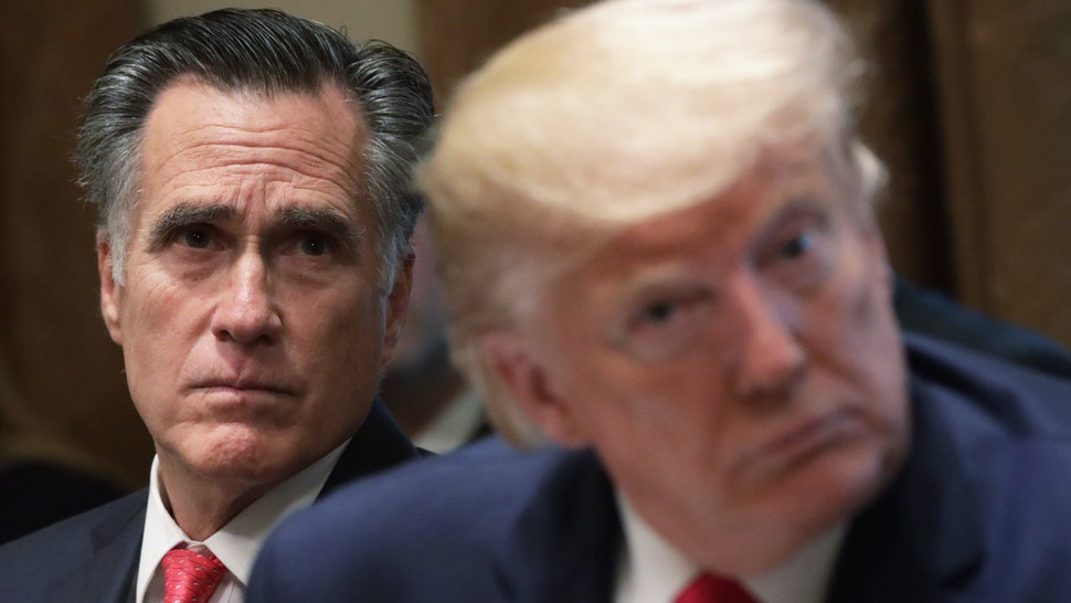 U.S. Sen. Mitt Romney (R-UT) and President Donald Trump listen during a listening session on youth vaping of electronic cigarette on November 22, 2019 in the Cabinet Room of the White House in Washington, DC.
