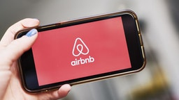 AirBnb Inc. signage is displayed on an smartphone in an arranged photograph taken in the Brooklyn borough of New York, U.S., on Friday, April 17, 2020.