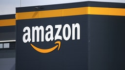 The logo of Amazon is seen on the facade of the company logistics center on April 21, 2020 in Bretigny-sur-Orge, France. The French government has ordered the American e-commerce giant Amazon to take measures at four of its sites in France to better protect employees against Covid-19. This Tuesday, the Versailles Court of Appeal examined the appeal filed by Amazon against a decision requiring it to restrict its activity in France during this period of confinement. Amazon Logistique France has finally decided to close all of its warehouses pending the decision of the Versailles Court of Appeal, which will be made on Friday April 24.