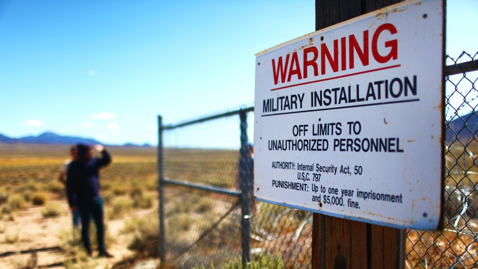 People gather at an entrance gate to the Nevada Test and Training Range, located near Area 51, on September 20, 2019 near Rachel, Nevada. People have gathered at the gate while in town attending 'Storm Area 51' spinoff events. The original Facebook event jokingly encouraged participants to charge the famously secretive Area 51 military base. The military has warned attendees not to approach the protected Area 51 military installation.