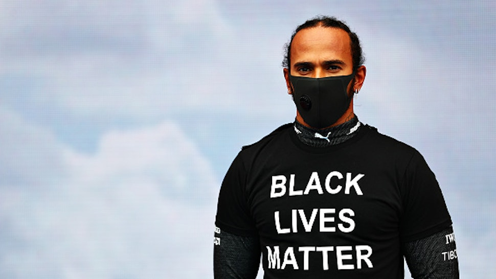 BUDAPEST, HUNGARY - JULY 19: Lewis Hamilton of Great Britain and Mercedes GP wears a Black Lives Matter on the grid before the Formula One Grand Prix of Hungary at Hungaroring on July 19, 2020 in Budapest, Hungary.