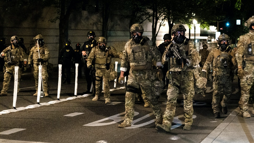 PORTLAND, OR - JULY 17: Federal officers prepare to disperse the crowd of protestors outside the Multnomah County Justice Center on July 17, 2020 in Portland, Oregon. Federal law enforcement agencies attempt to intervene as protests continue in Portland.
