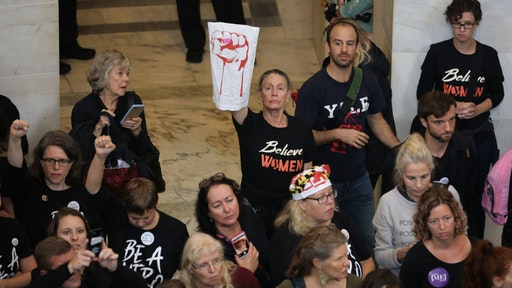Hundreds of protesters rally in the Russell Senate Office Building Rotunda while demonstrating against the confirmation of Judge Brett Kavanaugh on Capitol Hill September 24, 2018 in Washington, DC. Hundreds of people from half a dozen progressive organizations, including students from Yale University Law School, protested on Capitol Hill for a #BelieveSurvivors Walkout against Judge Kavanaugh, who has been accused by at least two women of sexual assault. (Photo by Chip Somodevilla/Getty Images)
