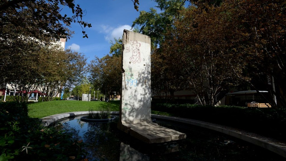 ORANGE, CA - NOVEMBER 13: A section of the Berlin Wall in Liberty Plaza at Chapman University on Thursday. The wall was acquired in 1999, thanks to a two-year effort by Chapman University President Jim Doti.
