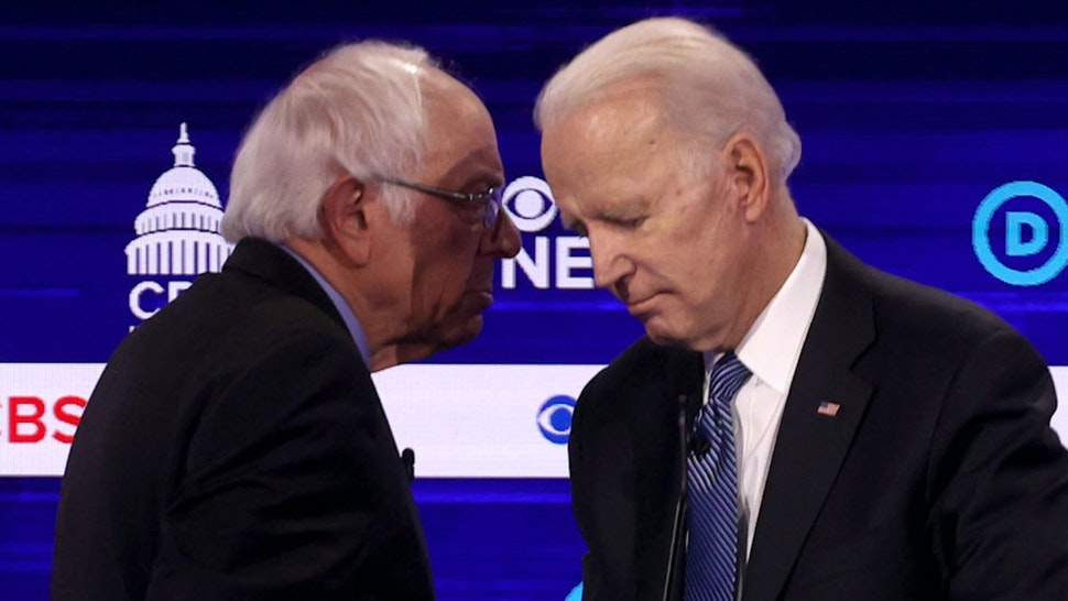 CHARLESTON, SOUTH CAROLINA - FEBRUARY 25: Democratic presidential candidates Sen. Bernie Sanders (I-VT) (L) and former Vice President Joe Biden speak during a break at the Democratic presidential primary debate at the Charleston Gaillard Center on February 25, 2020 in Charleston, South Carolina. Seven candidates qualified for the debate, hosted by CBS News and Congressional Black Caucus Institute, ahead of South Carolina's primary in four days.