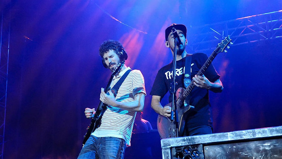 Brad Delson and Mike Shinoda of Linkin Park perform onstage during River City Rockfest at the AT&T Center on May 24, 2015 in San Antonio, Texas.