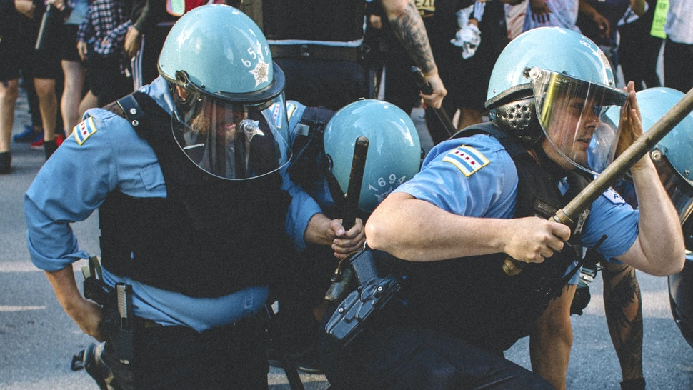 Protesters clash with police in Chicago , on May 30, 2020 during a protest against the death of George Floyd, an unarmed black man who died while while being arrested and pinned to the ground by the knee of a Minneapolis police officer.