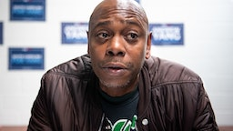 CHARLESTON, SC - JANUARY 30: Comedian Dave Chappelle talks with the media while campaigning for Democratic presidential candidate Andrew Yang on January 30, 2020 in North Charleston, South Carolina. The comedian has endorsed the candidate and performs the second of two South Carolina campaign benefit shows Thursday evening in Charleston.