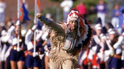 The Illinois Fighting Illini mascot Chief Illiniwek performs during the game against the Houston Cougars at Memorial Stadium on September 21, 1991 in Champaign, Illinois. Illinois won 51-10. (Photo by Bernstein Associates/Getty Images)