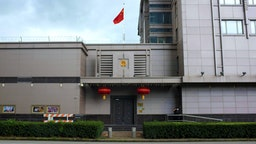The Chinese flag flies outside of the Chinese consulate in Houston after the US State Department ordered China to close the consulate in Houston, Texas, July 22, 2020. - US-Chinese tensions, already rising because of the coronavirus pandemic and crackdown in Hong Kong, ratcheted up another notch on Wednesday as the US ordered the closure of the Chinese consulate in Houston within 72 hours. China reacted angrily to the US move, which came a day after the unveiling of a US indictment of two Chinese nationals for allegedly hacking hundreds of companies worldwide.