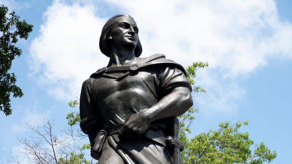 A statue of Christopher Columbus is pictured on July 9, 2020 in the Astoria neighbourhood in the Queens borough of New York City. - Activists have called for the removal of monuments that are harmful to minority groups across the country. (Photo by Johannes EISELE / AFP) (Photo by JOHANNES EISELE/AFP via Getty Images)