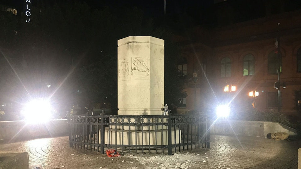 Remains of the Christopher Columbus statue near Little Italy after it was ripped from its pedestal and dragged into the Jones Falls by protesters in Baltimore on Saturday, July 4, 2020.