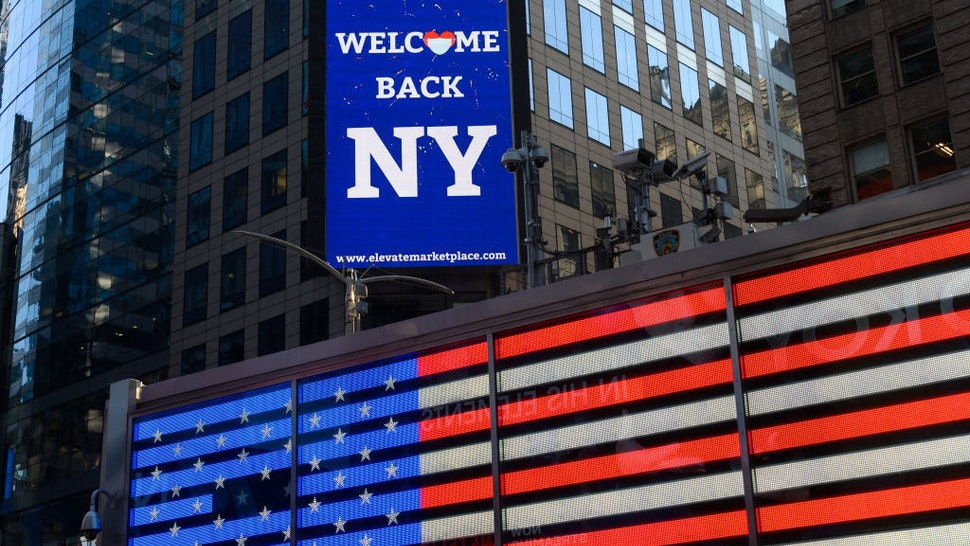 A 'Welcome back NY' billboard is seen in Times Square as the city moves into Phase 2 of re-opening following restrictions imposed to curb the coronavirus pandemic on June 23, 2020 in New York City. Phase 2 permits the reopening of offices, in-store retail, outdoor dining, barbers and beauty parlors and numerous other businesses. Phase 2 is the second of four-phased stages designated by the state. (Photo by Noam Galai/Getty Images)