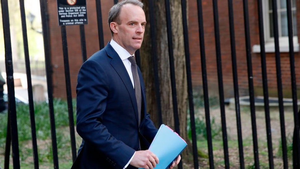 """Britain's Foreign Secretary Dominic Raab arrives for a COBRA meeting at 10 Downing street in central London on April 9, 2020. - British Prime Minister Boris Johnson's health """"continues to improve"""" on his fourth day in COVID-19 intensive care, his spokesman said Thursday, while the government prepared to extend a nationwide lockdown. (Photo by Tolga AKMEN / AFP) (Photo by TOLGA AKMEN/AFP via Getty Images)"""