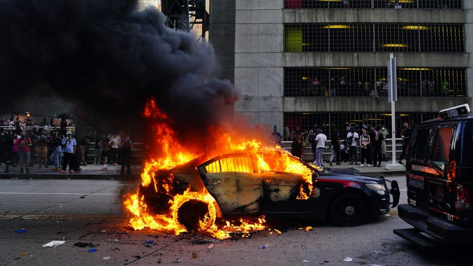A burning police car is seen during a protest on May 29, 2020 in Atlanta, Georgia. Demonstrations are being held across the US after George Floyd died in police custody on May 25th in Minneapolis, Minnesota.