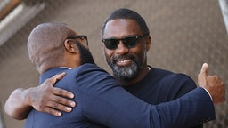 HOLLYWOOD, CALIFORNIA - OCTOBER 01: Tyler Perry and Idris Elba attend the ceremony honoring Tyler Perry with a Star on The Hollywood Walk of Fame held on October 01, 2019 in Hollywood, California.