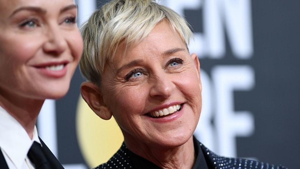 US actress Portia de Rossi (L) and US comedian Ellen DeGeneres arrives for the 77th annual Golden Globe Awards on January 5, 2020, at The Beverly Hilton hotel in Beverly Hills, California.