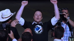 CAPE CANAVERAL, UNITED STATES - 2020/05/30: SpaceX founder Elon Musk celebrates after being recognized by U.S. Vice President Mike Pence at NASA's Vehicle Assembly Building following the successful launch of a Falcon 9 rocket with the Crew Dragon spacecraft from pad 39A at the Kennedy Space Center.