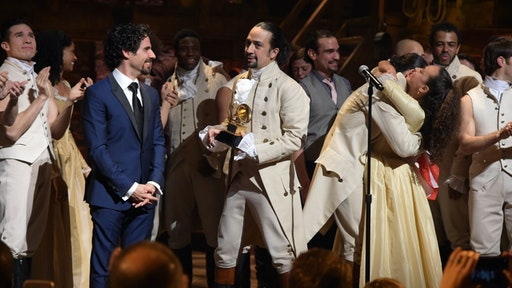 "Music director Alex Lacamoire and actor, composer Lin-Manuel Miranda and cast of ""Hamilton"" celebrate on stage the receiving of GRAMMY award after ""Hamilton"" GRAMMY performance for The 58th GRAMMY Awards at Richard Rodgers Theater on February 15, 2016 in New York City."