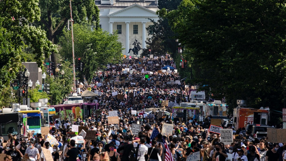 Protesters stretch for more than five blocks, from Scott Circle NW to H Street NW, during demonstrations over the death of George Floyd near the White House on June 6, 2020 in Washington, DC.