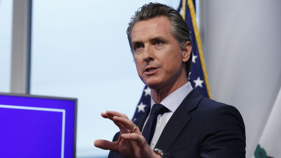Gavin Newsom, governor of California, speaks during a news conference in Sacramento, California, U.S., on Tuesday, April 14, 2020. Newsom outlined his plan to lift restrictions in the most-populous U.S. state, saying a reopening depends on meeting a series of benchmarks that would remake daily life for 40 million residents. Photographer: Rich Pedroncelli/AP/Bloomberg