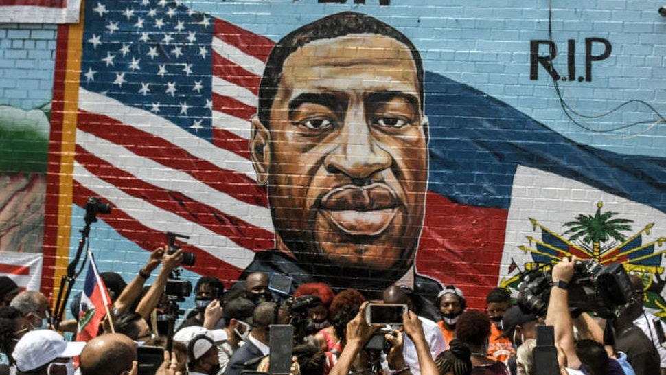 A mural painted by artist Kenny Altidor depicting George Floyd is unveiled on a sidewall of CTown Supermarket on July 13, 2020 in the Brooklyn borough New York City. George Floyd was killed by a white police officer in Minneapolis and his death has sparked a national reckoning about race and policing in the United States. (Photo by Stephanie Keith/Getty Images)