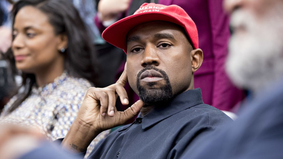 Rapper Kanye West listens during a meeting with U.S. President Donald Trump, not pictured, in the Oval Office of the White House in Washington, D.C., U.S., on Thursday, Oct. 11, 2018.