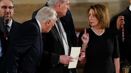 House Minority Leader Nancy Pelosi (D-CA) talks with House Majority Leader Kevin McCarthy (R-CA) (C) and House Minority Whip Steny Hoyer, (D-Md) (L), as they arrive at the U.S Capitol Rotunda on December 03, 2018 in Washington, DC