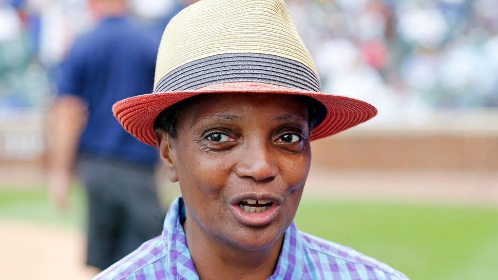 Chicago mayor Lori Lightfoot stands on the field during a ceremony honoring Lee Smith's induction into the Baseball Hall of Fame prior to a game between the Chicago Cubs and the Milwaukee Brewers at Wrigley Field on September 01, 2019 in Chicago, Illinois.