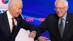 TOPSHOT - Democratic presidential hopefuls former US vice president Joe Biden (L) and Senator Bernie Sanders greet each other with a safe elbow bump before the start of the 11th Democratic Party 2020 presidential debate in a CNN Washington Bureau studio in Washington, DC on March 15, 2020. (Photo by Mandel NGAN / AFP) (Photo by MANDEL NGAN/AFP via Getty Images)