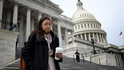 ASHINGTON, DC - MARCH 27: Rep. Alexandria Ocasio-Cortez (D-NY) leaves the U.S. Capitol after passage of the stimulus bill known as the CARES Act on March 27, 2020 in Washington, DC. The stimulus bill is intended to combat the economic effects caused by the coronavirus pandemic. (Photo by Win McNamee/Getty Images)