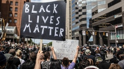 A protester holds a placard that says Black Lives Matter during the demonstration.