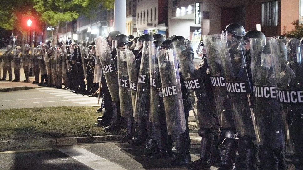 PORTLAND, ME - JUNE 2: Police in riot gear form a line across Franklin Arterial on Tuesday night. (Staff Photo by Gregory Rec/Portland Press Herald via Getty Images)