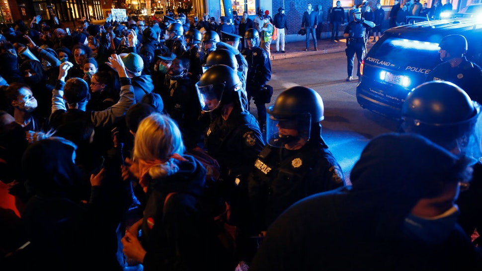 More than 1,000 demonstrators swarmed Portlands streets Monday night to protest institutional racism and violence by police against people of color.