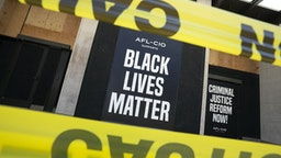A Black Lives Matter sign is displayed on the American Federation of Labor and Congress of Industrial Organizations (AFL-CIO) building near the White House in Washington, D.C., U.S., on Sunday, June 14, 2020. Atlanta Police Chief Erika Shields resigned Saturday after an officer fatally shot a black man the night before in a Wendy's parking lot. Photographer: Stefani Reynolds/Bloomberg via Getty Images