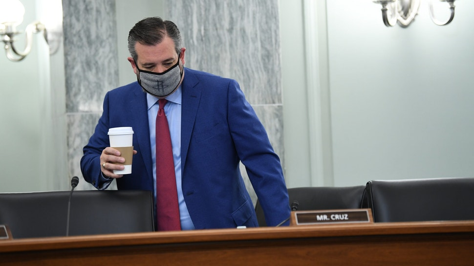 Senator Ted Cruz, a Republican from Texas, wears a protective mask while arriving to a Senate Commerce, Science and Transportation Committee hearing in Washington, D.C., U.S., on Wednesday, June 24, 2020. The Federal Communications Commission (FCC) has increasingly scrutinized Chinese companies as tensions grow between Beijing and Washington over trade, the coronavirus and security issues. Photographer: Jonathan Newton/The Washington Post/Bloomberg via Getty Images
