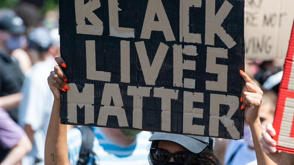 """27 June 2020, Berlin: A participant of the """"Black Lives Matter"""" demonstration holds a poster with the words """"Black Lives Matter"""". More than 1000 people demonstrated against racism on the street of June 17. Photo: Christophe Gateau/dpa (Photo by Christophe Gateau/picture alliance via Getty Images)"""