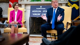 Trump meets with Iowa Governor Kim Reynolds in the Oval Office at the White House as he continues to promote re-opening business during the coronavirus pandemic May 06, 2020 in Washington, DC.