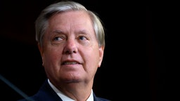 Senator Lindsey Graham, a Republican from South Carolina, listens during a news conference on Republican opposition to statehood for the District of Columbia at the U.S. Capitol in Washington, D.C., U.S., on Wednesday, July 1, 2020.