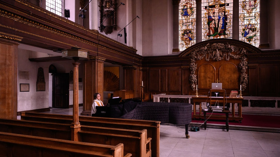 The reverend Lucy Winkett, rector of St James's Piccadilly, plays piano as she sings a hymn during the service on Rogation Sunday via webcam to the church's congregation on May 17, 2020 in London, England.