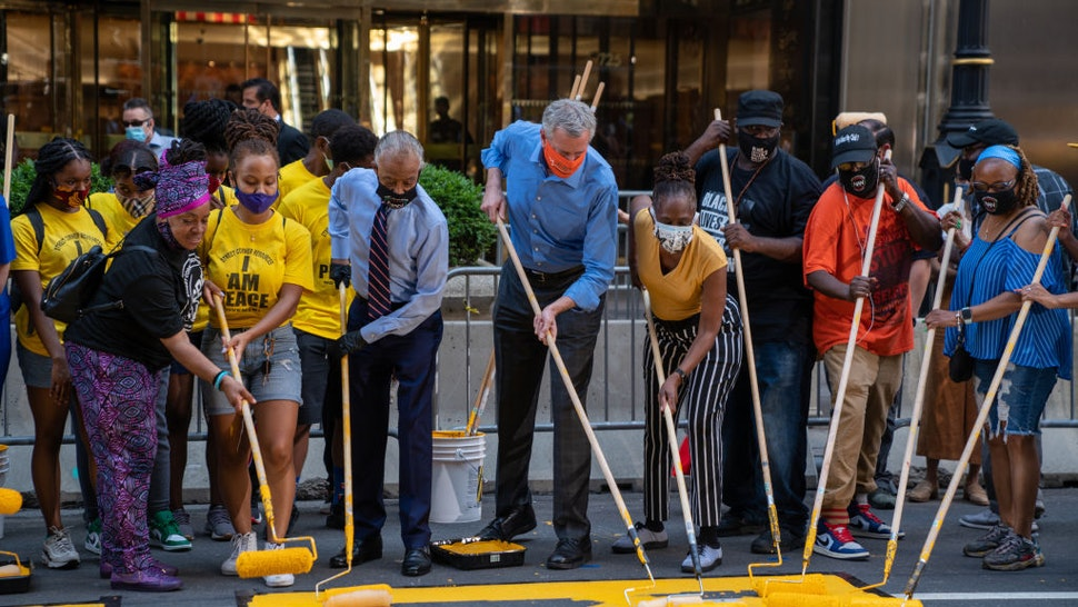 New York City Mayor Bill de Blasio, his wife Chirlane McCray and Rev. Al Sharpton help paint a Black Lives Matter mural on Fifth Avenue directly in front of Trump Tower on July 9, 2020 in New York City.