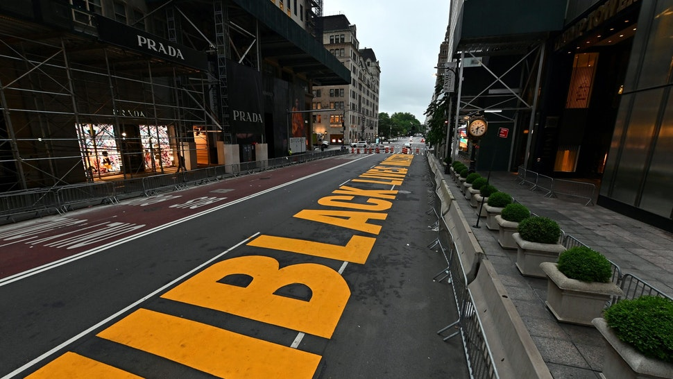 A newly painted Black Lives Matter mural adorns Fifth Avenue outside of Trump Tower on July 10, 2020 in New York City. (Photo by Angela Weiss / AFP) (Photo by ANGELA WEISS/AFP via Getty Images)