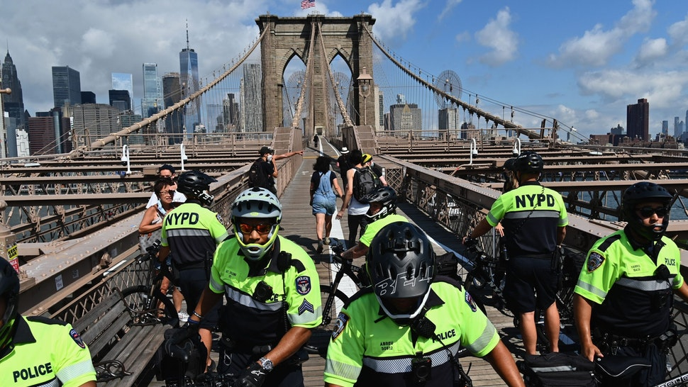 People get arrested on the Brooklyn Bridge during a protest on July 15, 2020 in New York City. - About a dozen Black Lives Matter protesters briefly shut down the Brooklyn Bridge on Wednesday morning. (Photo by Angela Weiss / AFP) (Photo by ANGELA WEISS/AFP via Getty Images)
