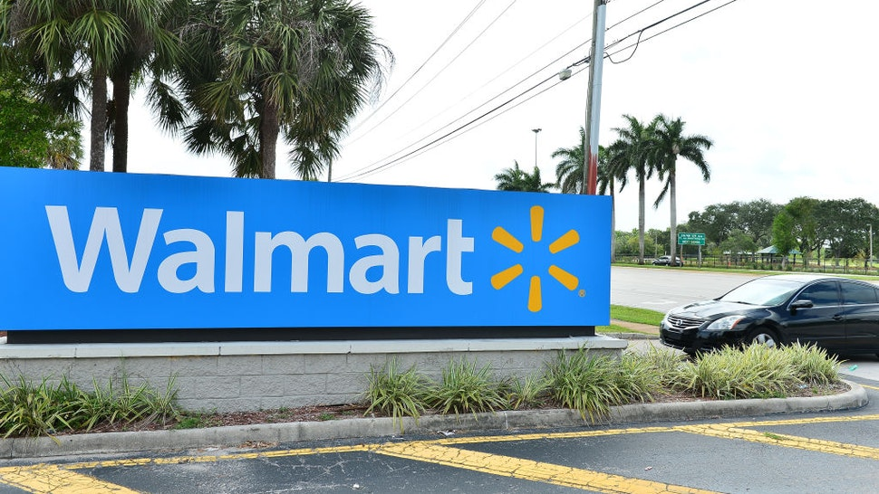 A view outside a Walmart retail store is seen on July 16, 2020 in Pembroke Pines, Florida. Some major U.S. corporations are requiring masks to be worn in their stores upon entering to control the spread of COVID-19.