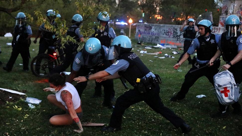 A protester and Chicago police clash after protesters tried to topple the Christopher Columbus statue in Grant Park during a rally on July 17, 2020. (Chris Sweda/Chicago Tribune/Tribune News Service via Getty Images)
