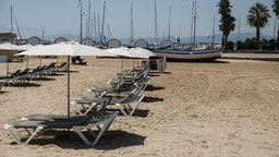 Empty sun loungers sit on the sand at the beach in Salou, Spain, on Monday, July 27, 2020. Spain's tourism industry is at increasing risk of being shut down as countries across Europe seek to restrict visits to the Mediterranean nation, following an order by the British government to quarantine visitors. Photographer: Angel Garcia/Bloomberg via Getty Images
